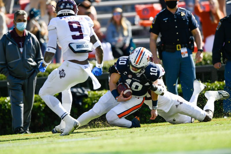 Bo Nix (10) runs for the first down setting up the touchdown during the game between Auburn and Texas A&M at Jordan Hare Stadium on Dec. 5, 2020; Auburn AL, USA. Photo via: Todd Van Emst/AU Athletics