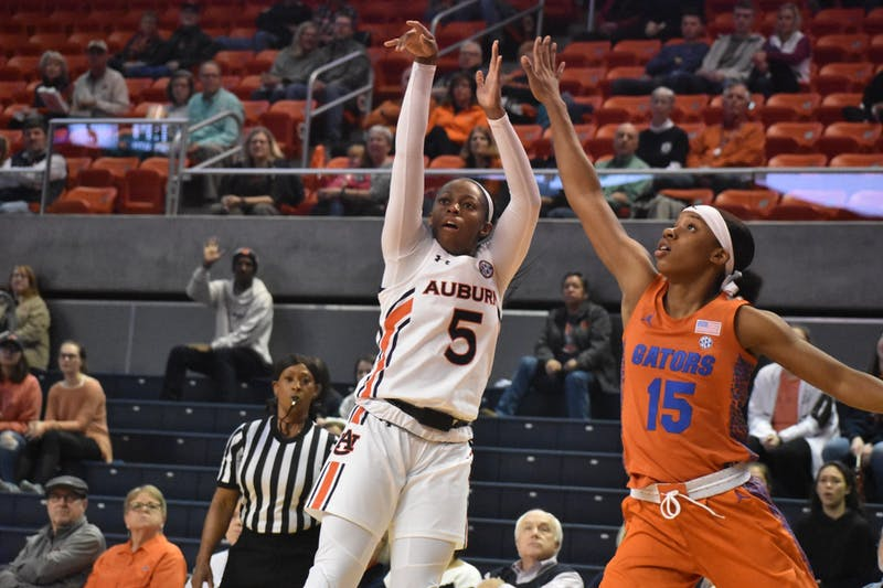 Auburn player Brooke Moore (5) shoots the ball at the Auburn v. Florida Women's Basketball Game in Auburn, AL on January 1st, 2020