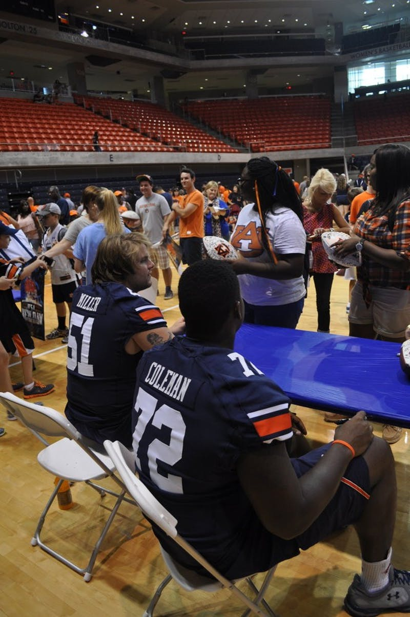 Offensive linemen, Patrick Miller and Shon Coleman at Fan Day 2013. (File photo)