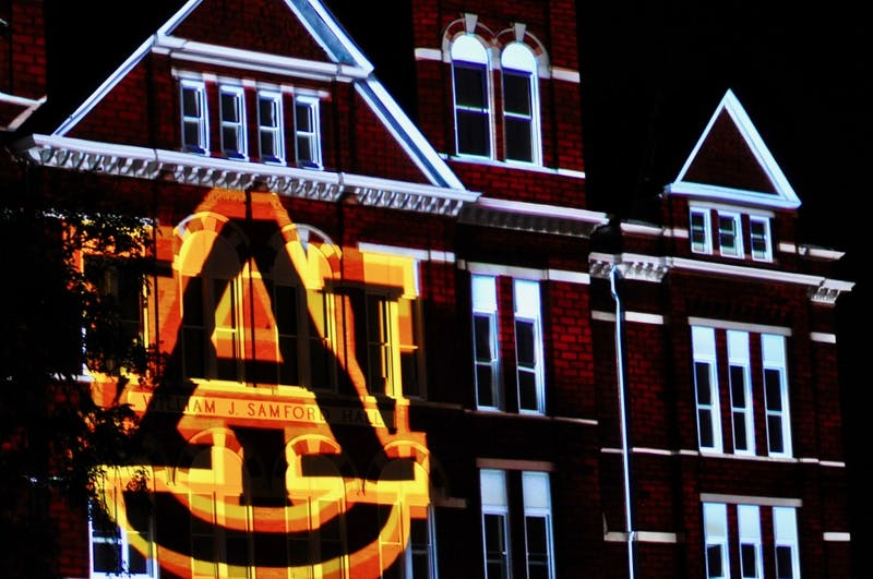 Light show on Samford Hall as a thank you to donors on Friday, Sept. 14, 2018 in Auburn, Ala.