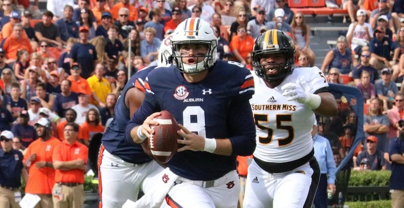 Jarrett Stidham (8) scrambles during Auburn vs. Southern Miss on Sept. 29, 2018, in Auburn, Ala.