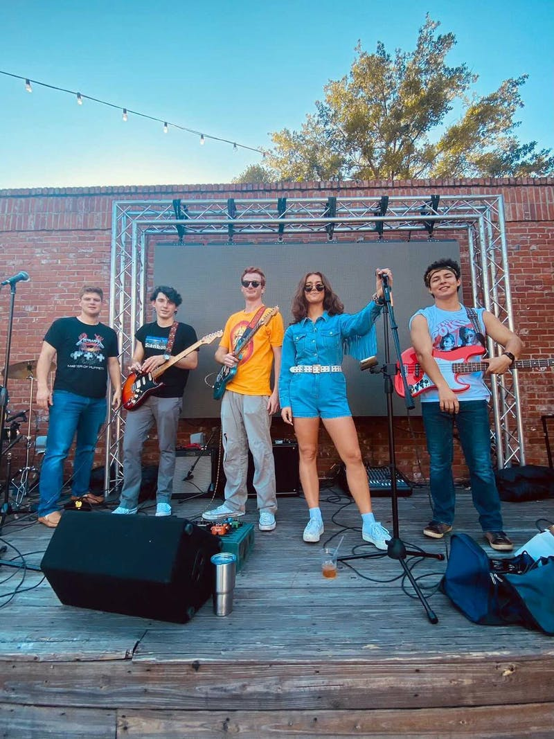 New student-run band, Queen of Kings, draws crowds at live performances in downtown Auburn.