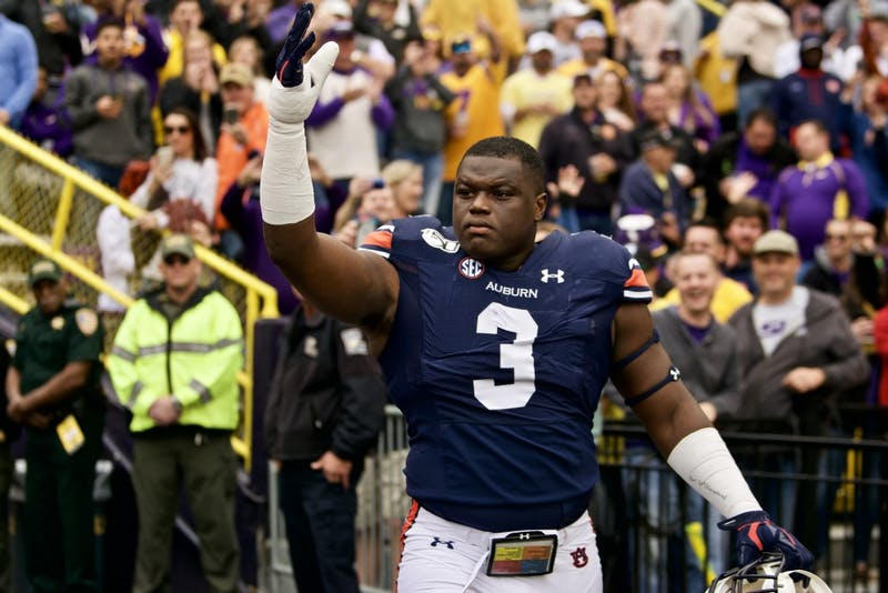 Marlon Davidson (3) waves to Auburn fans during the Auburn vs. LSU game Saturday Oct. 26, 2019, in Baton Rogue, La.