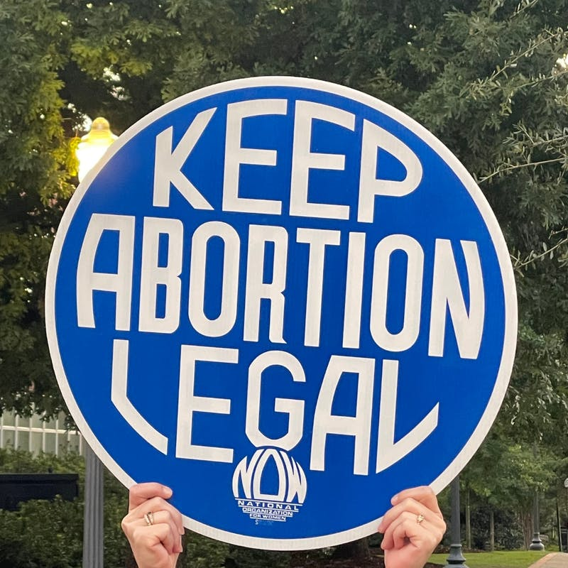 """A sign that reads """"Keep Abortion Legal"""" is held at Toomer's Corner on Sept. 9, 2021."""
