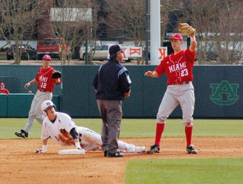 Sophomore Creede Simpson slides into second base against Miami Sunday.