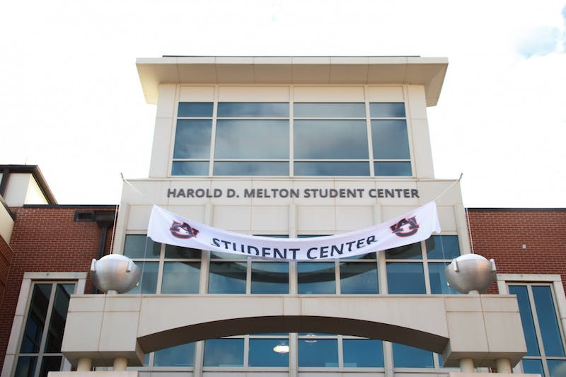 A banner is lowered signaling the dedication of the Harold D. Melton Student Center on Nov. 20, 2020, in Auburn, Ala.