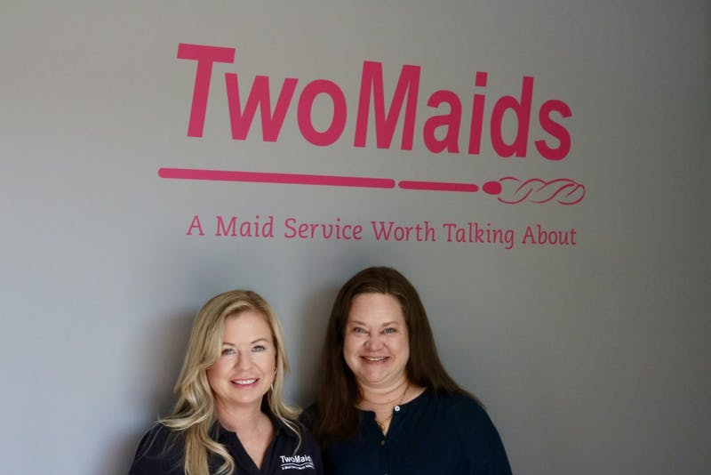 Nicole Akers and Chrissy of Two Maids cleaning offer free cleaning services to Breast Cancer victims on Friday, Oct. 4, 2019, in Auburn, Ala.