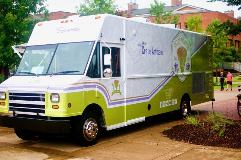 The Crepe Myrtle Truck serves food to students on Monday, Aug. 20, 2018 in Auburn, Ala.