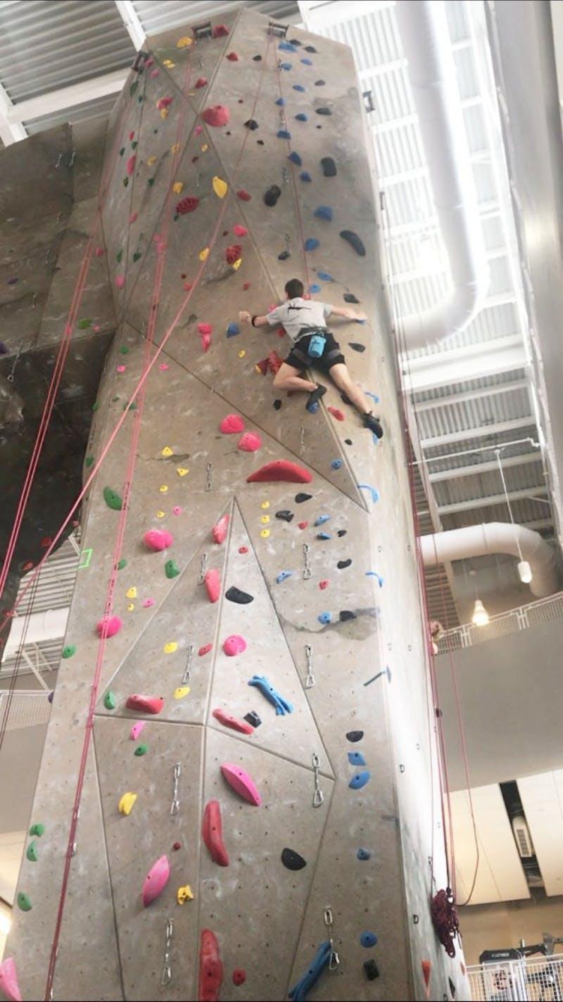 Student climbs rock wall at the Auburn Rec Center