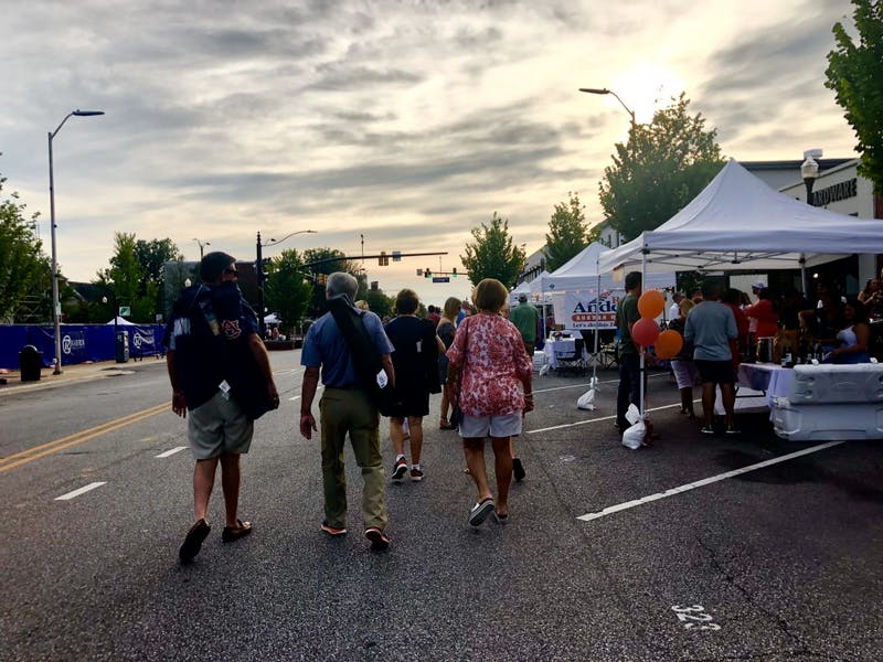 Members of the Auburn community attend Cheers on the Corner on Friday, July 20, 2018 in Auburn, Ala.