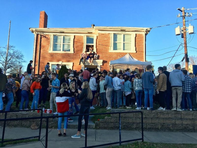 "Students gather outside of Stephen Herrera's house on West Magnolia Avenue commonly referred to as ""Pizza Frat."""