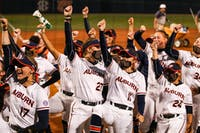 The team reacts after a win during the game between Auburn and Kentucky at Jane B. Moore Field on April 16, 2021; Auburn, AL, USA. Photo via: Jacob Taylor/AU Athletics