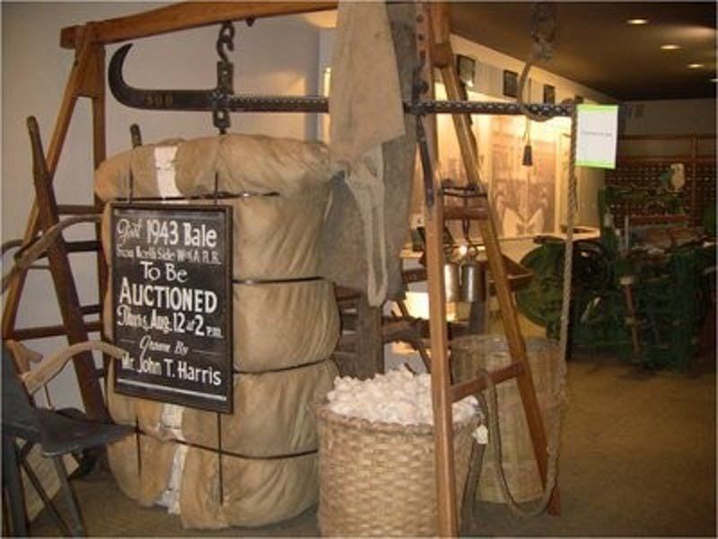 500 lb. bale of cotton and scale formerly owned by John T. Harris, one of the founders of the museum. (Nathan Simone / ONLINE EDITOR)