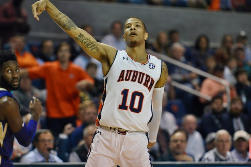 Samir Doughty (10) shoots a three pointer during Auburn Basketball vs. Washington on Friday, Nov. 9, 2018 in Auburn, Ala.