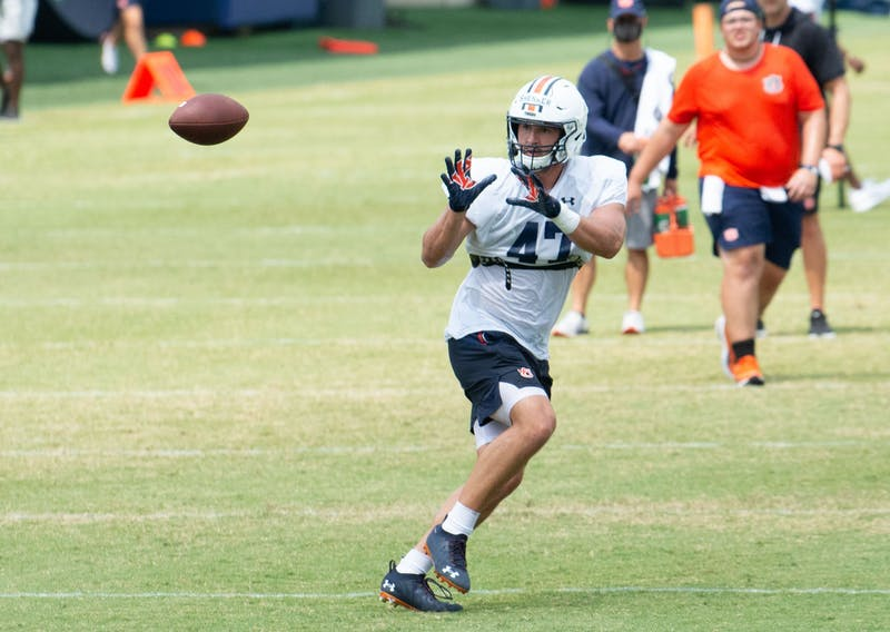 john Samuel Shenker (47) catches a pass during practice on Aug. 10, 2021.