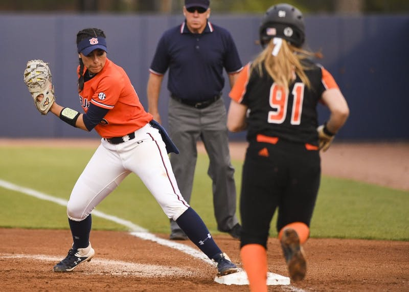 Justus Perry (18) tags first base during Auburn softball vs. Mercer on March 8, 2019, in Auburn, Ala.