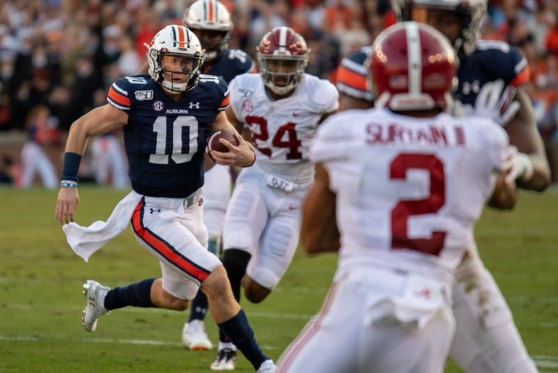 Bo Nix (10) runs the ball during Auburn Football vs. Alabama, on Saturday, Nov. 30, 2019, in Auburn, Ala.
