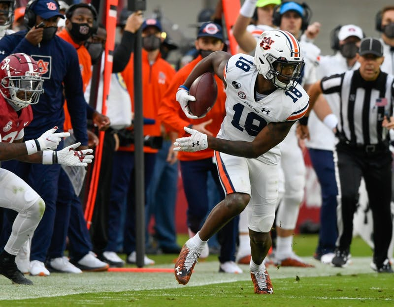 Nov. 28, 2020; Tuscaloosa AL, USA; Seth Williams (18) with a first down reception during the game between Auburn and Alabama at Bryant Denny Stadium.