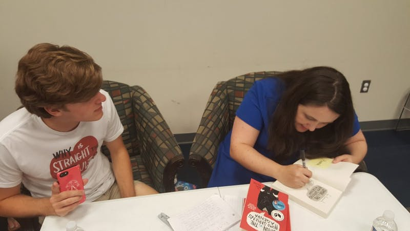 Matthew Epperd (left) and Becky Albertalli (right) chat during a book signing at the Auburn Public Library on Aug. 26, 2018 in Auburn, Ala.