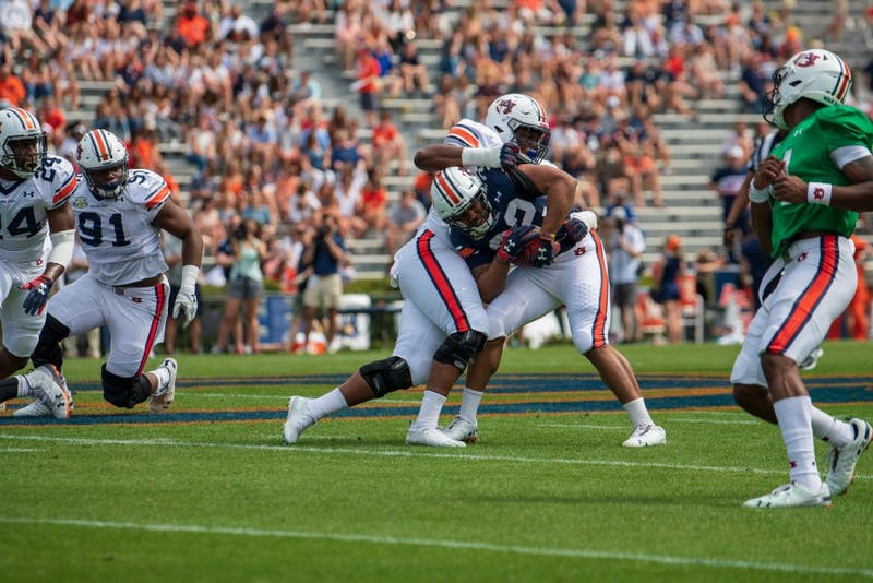 Malik Miller (32) protects the ball during A-Day 2019, on Saturday, April 13, 2019, in Auburn, Ala.