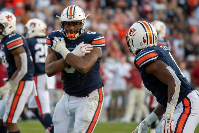 Derrick Brown (5) signals Big Kat Bryant (1) during Auburn Football vs. Alabama, on Saturday, Nov. 30, 2019, in Auburn, Ala.