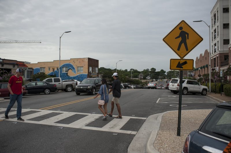 The mid-block crosswalk on North College Street between Magnolia and Tichenor Avenues.