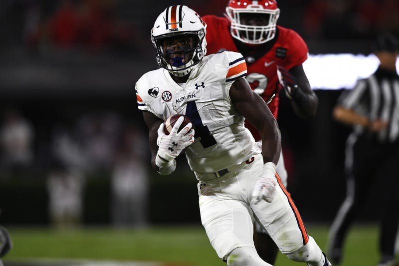 Oct 3, 2020; Athens, GA, USA; Tank Bigsby (4) runs the ball in the second quarter during the game between Auburn and Georgia at Samford Stadium. Todd Van Emst/AU Athletics