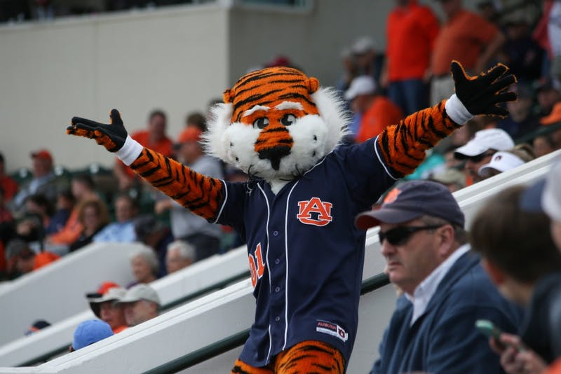 Aubie celebrates in the stands after a home run was hit by Luke Jarvis (9) during Auburn Baseball vs. Arkansas on Sunday, April 23, 2017 in Auburn, Ala.