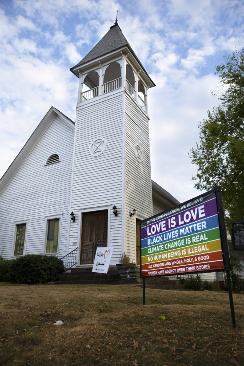The front of the Auburn Unitarian Universalist Fellowship and the sign that displays some of their beliefs on October 7, 2019.