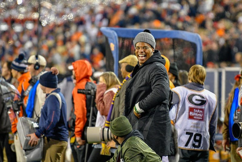 Cam Newton laughs on the sideline during Auburn Football vs. Georgia on Saturday, Nov. 10, 2018, in Athens, Ga.