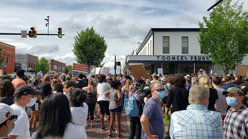 Protestors gather on Toomer's Corner on June 7, 2020, in Auburn, Ala.