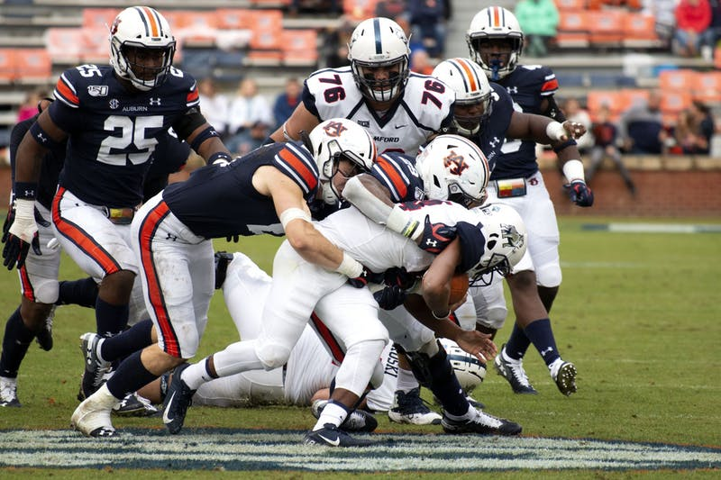 Auburn Football players tackle their Samford opponent during the Auburn vs. Samford Football game on Nov. 23, 2019, in Auburn, AL.