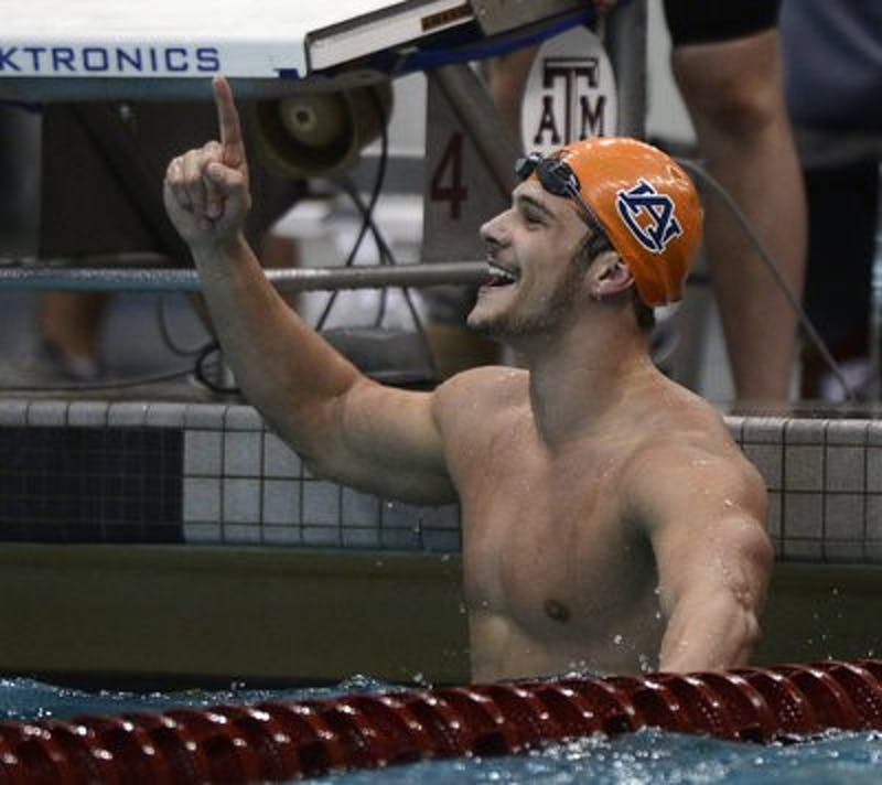 Auburn's Marcelo Chierighini celebrates winning the SEC Championship in the 50-yard freestyle Wednesday, Feb. 20. (Courtesy of Todd Van Emst)