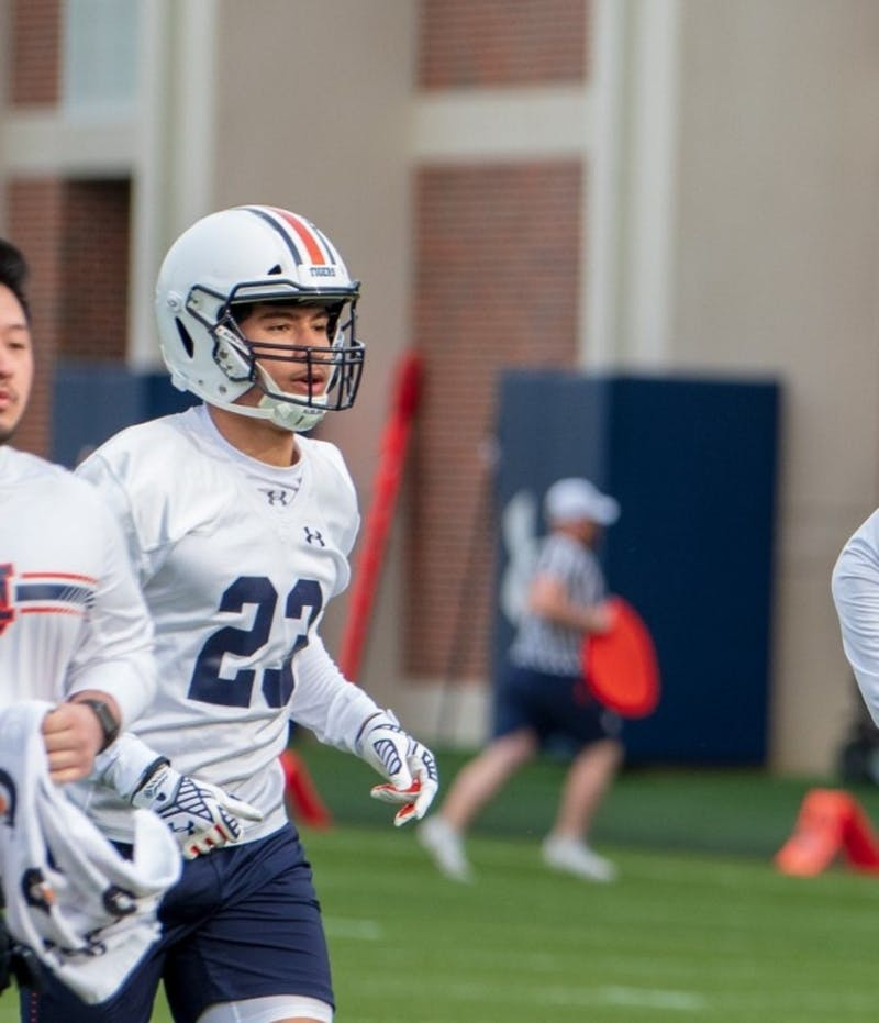 Cam'Ron Kelly (23) runs during Auburn Footballs first Spring Practice, on Monday, March 18, 2019, in Auburn, Ala.