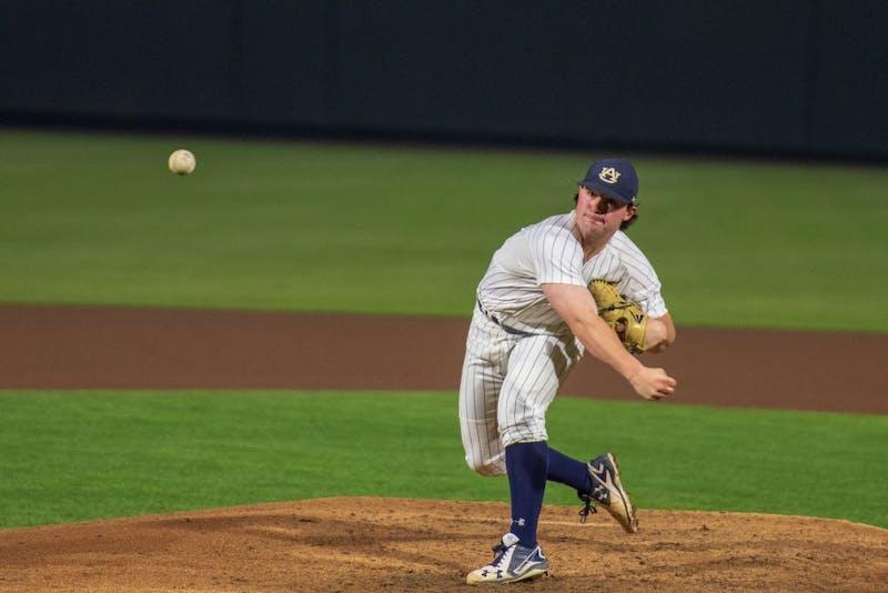 Tanner Burns (32) throws the ball towards home plate during Auburn Baseball vs. UTSA Friday, March 8, 2019, in Auburn, Ala.