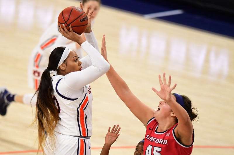 Unique Thompson (20) shoots over Natalie Armstrong (45) during the game between Auburn and Samford at Auburn Arena on Nov 28, 2020; Auburn, AL, USA. Photo via: Shanna Lockwood/AU Athletics