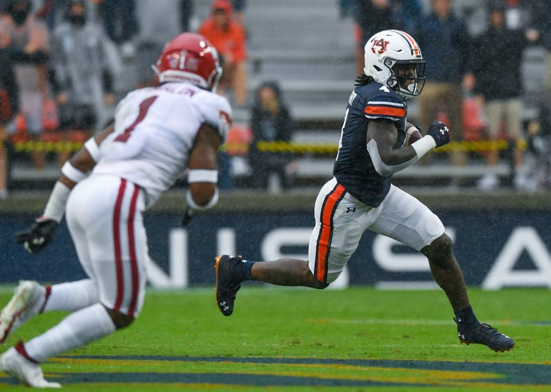 Oct 3, 2020; Auburn, AL, USA; Tank Bigsby (4) rushes for the first down during the game between Auburn and Arkansas at Jordan-Hare Stadium. Todd Van Emst/AU Athletics
