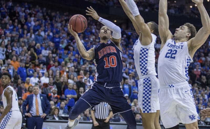 Samir Doughty (10) attacks the basket during Auburn basketball vs. Kentucky in the Midwest Regional Final of the 2019 NCAA Tournament on March 31, 2019, in Kansas City, Mo. Photo courtesy Lauren Talkington / The Glomerata.