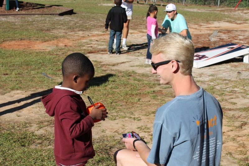Students volunteer through IMPACT at Joyland daycare