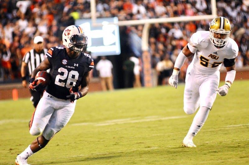 JaTarvious Whitlow (28) runs the ball during the Alabama State vs. Auburn football game on Saturday, Sept. 8, 2018, in Auburn, Ala.