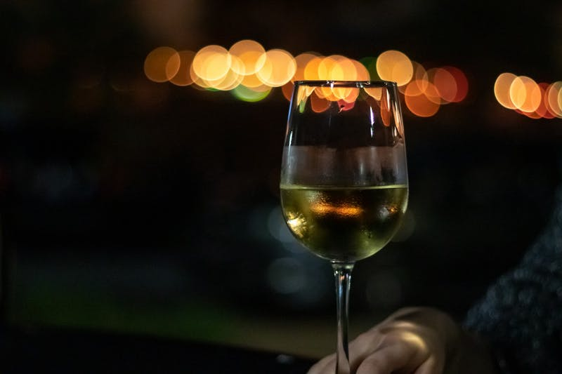 A glass of wine is enjoyed at Well Red on Friday, Feb. 26, 2021, in Auburn, Ala.