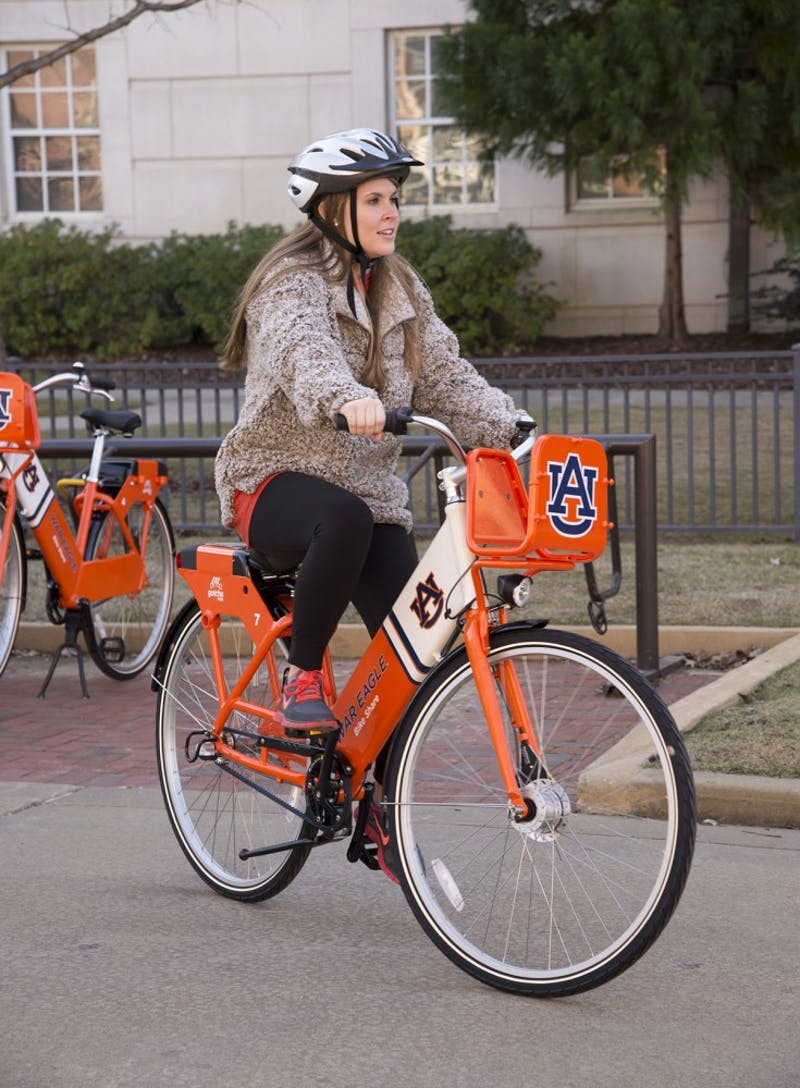 Auburn University student Caitlin Miley tries one of the new War Eagle Bike Share bicycles.