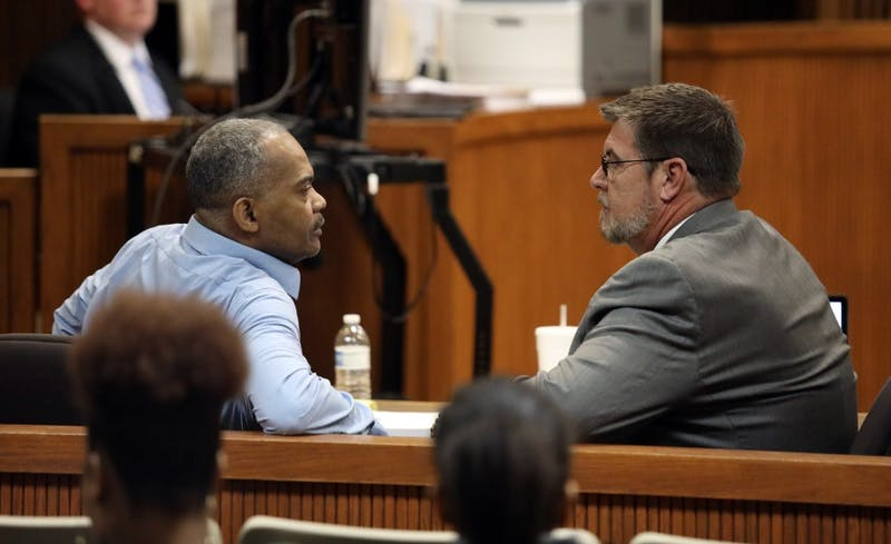 Defendant Tony Patillo, left, speaks with his attorney, Jon Taylor, right, on Thursday, Feb. 28, 2019, during the second day of the Tiger Transit rape trial at the Lee County Justice Center in Opelika.
