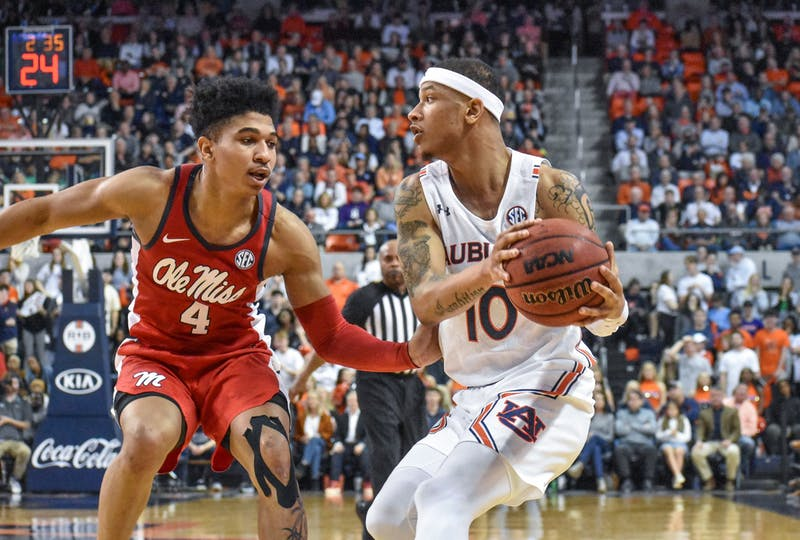Samir Doughty (10) drives to the basket against Ole Miss' Breein Tyree (4) during Auburn basketball vs. Ole Miss on Feb. 25, 2020, in Auburn, Ala.