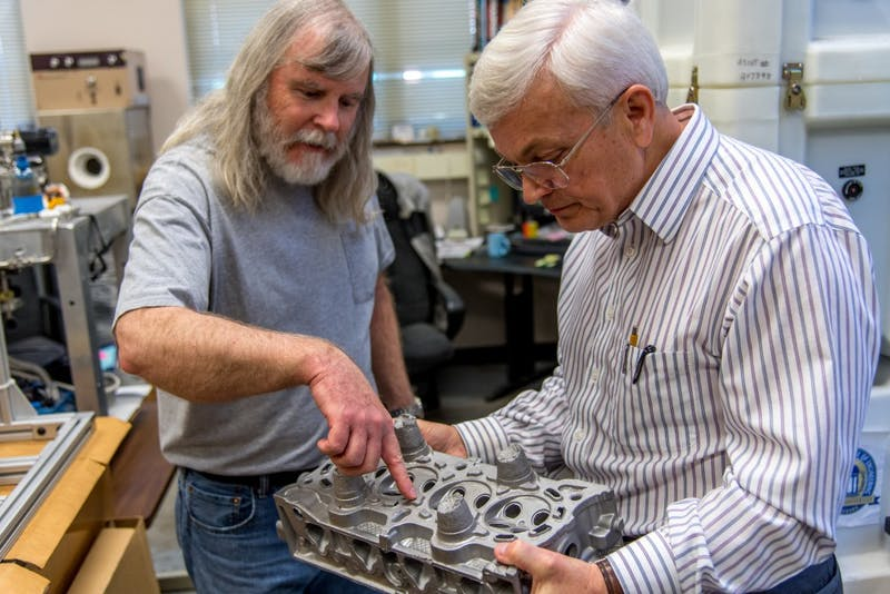 Lab technician Mike Crumpler, left, and materials engineering professor Tony Overfelt examine metal components in one of Auburn's additive manufacturing labs. Overfelt is director of the Center for Industrialized Additive Manufacturing and principal investigator on a separate $1.5 million grant from the National Institute of Standards and Technology to research ways for smaller manufacturers to incorporate additive technology into their processes.