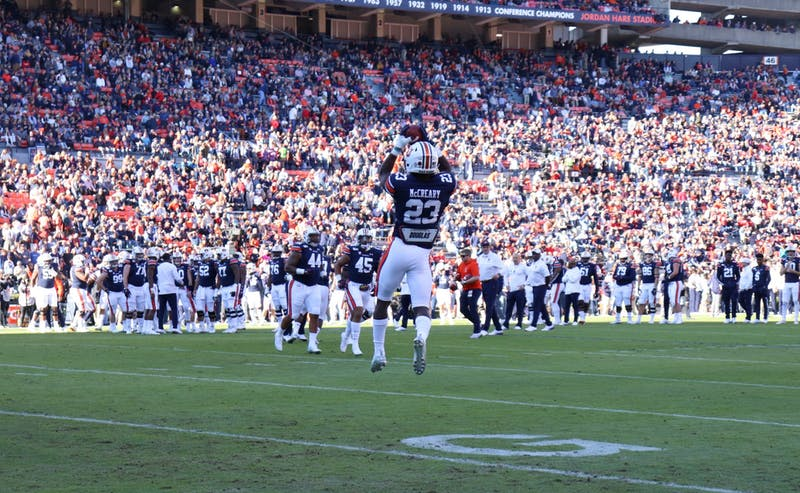 Roger McCreary (23) catches the ball while warming up at Auburn Football vs. Georgia on Nov. 16, 2019, in Auburn, Ala.