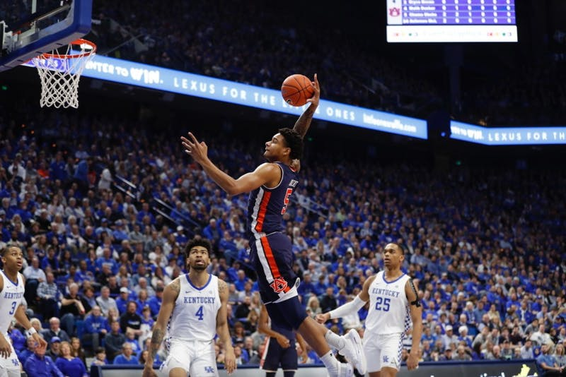 Chuma Okeke (5) dunks the ball during Auburn men's basketball vs. Kentucky on Feb. 23, 2019, in Lexington, Ky.