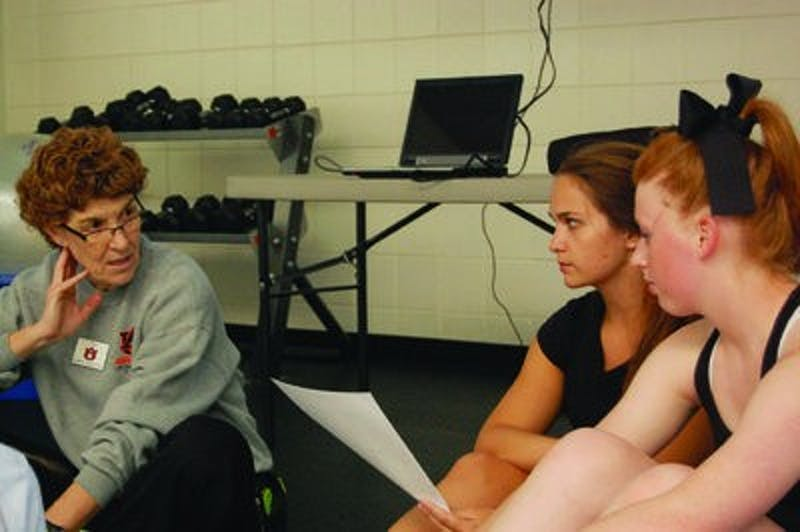 Pam Wiggins (left to right) teaches her students Laurel Hicks, junior in nutrition and dietetics, and Mackenzie Horsefield, freshman in exercise science, about different rhythm concepts for Group Fitness Instructor Training.