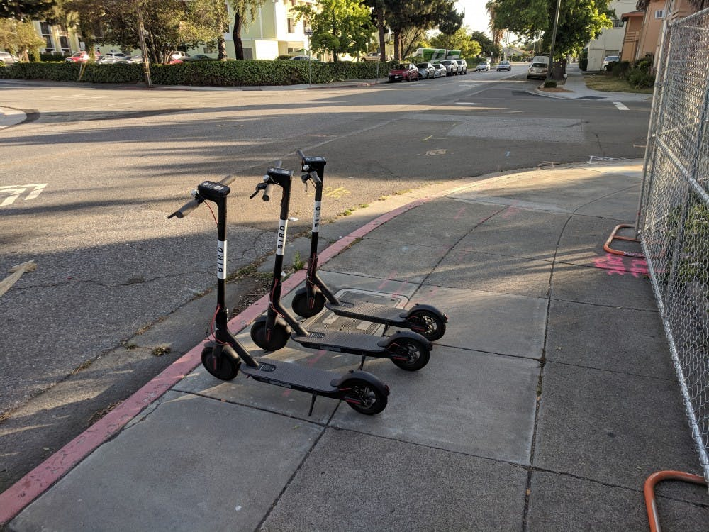 bird-scooters-on-the-sidewalk