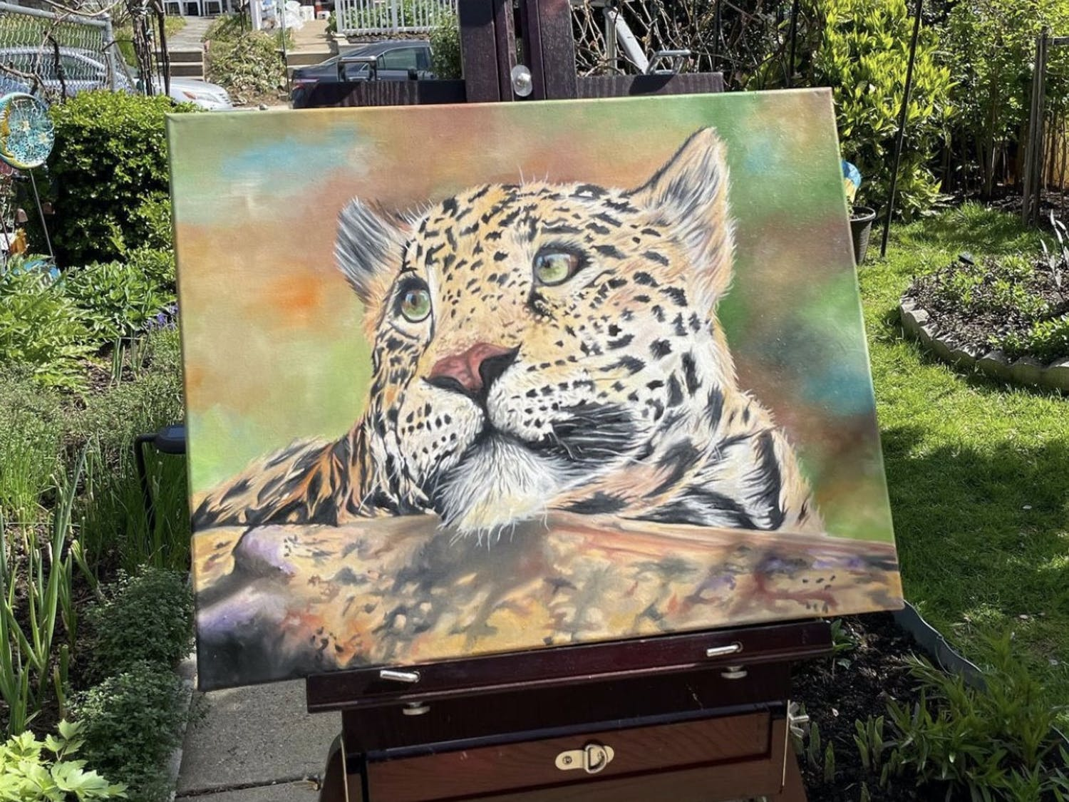 I'm Ivanna Dudych, a senior at Mast Community Charter School and this is my oil painting of leopard I created for my mother. I made this painting to experiment with different colors and brush stroke techniques to get the realistic feel of the painting.